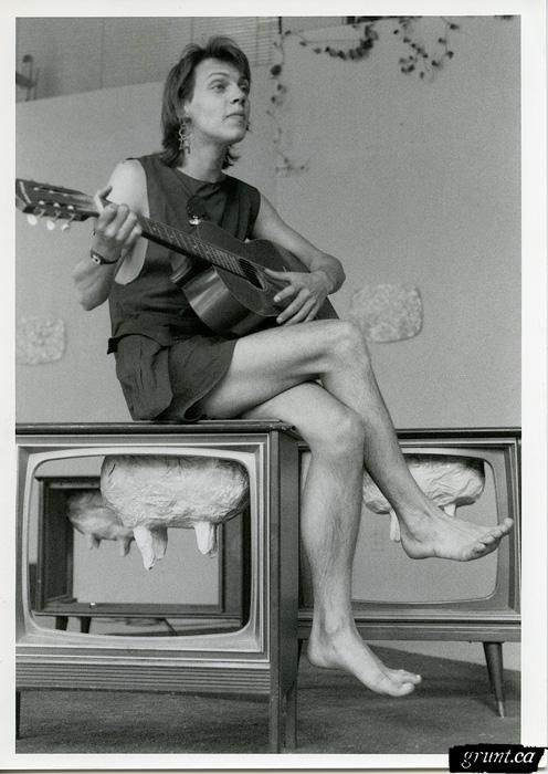 1986 06 24 Sculpture Kempton Dexter Digby County Pasture androgynous figure sitting on sculpture with guitar